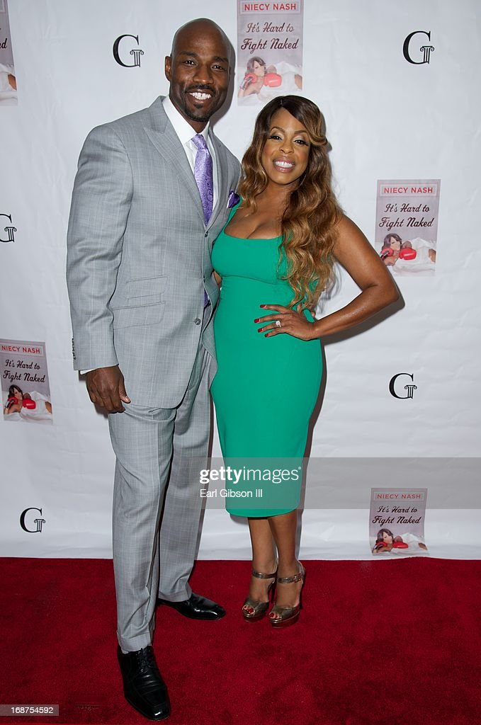 Jay Tucker and wife Niecy Nash at the release of 'It's Hard to Fight Naked' by Niecy Nash at Luxe Rodeo Drive Hotel on May 14, 2013 in Beverly Hills, California.