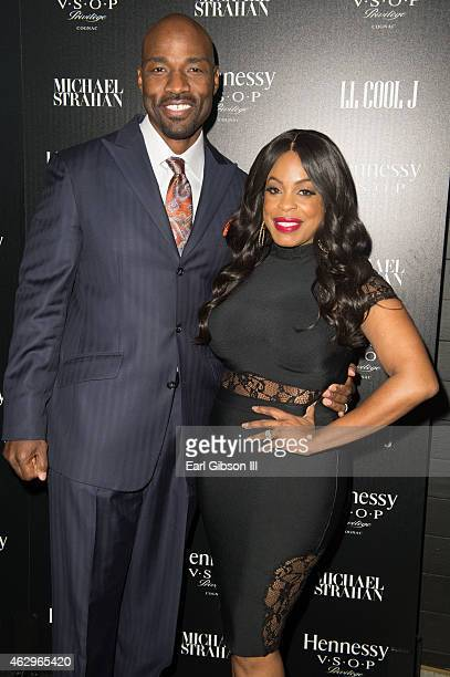 Jay Tucker and wife Niecy Nash attend the Hennesst Toasts Achievements In Music on February 7 2015 in Los Angeles California