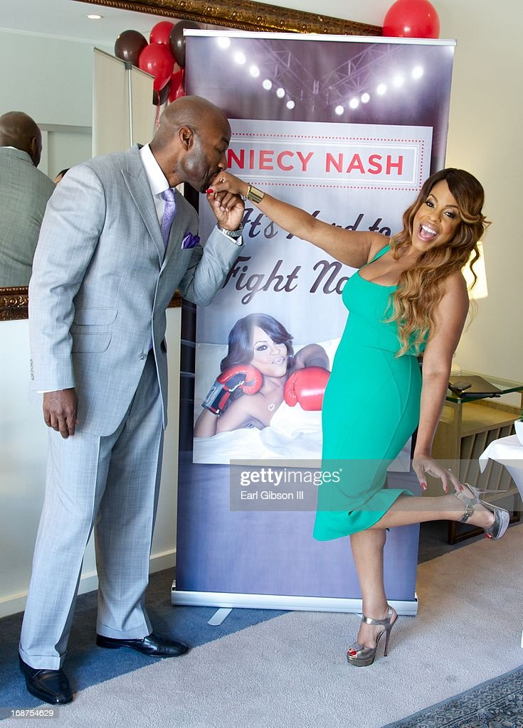 Jay Tucker and wife Niecy Nash celebrate the release of her new book 'It's Hard to Fight Naked' at Luxe Rodeo Drive Hotel on May 14, 2013 in Beverly Hills, California.
