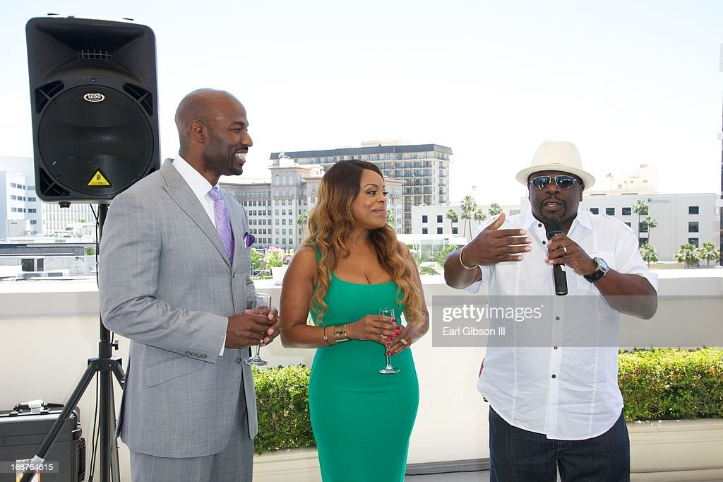 Jay Tucker, Niecy Nash and Cedric The Entertainer share a moment at the release party for Niecy Nash's book 'It's Hard to Fight Naked' at Luxe Rodeo Drive Hotel on May 14, 2013 in Beverly Hills, California.