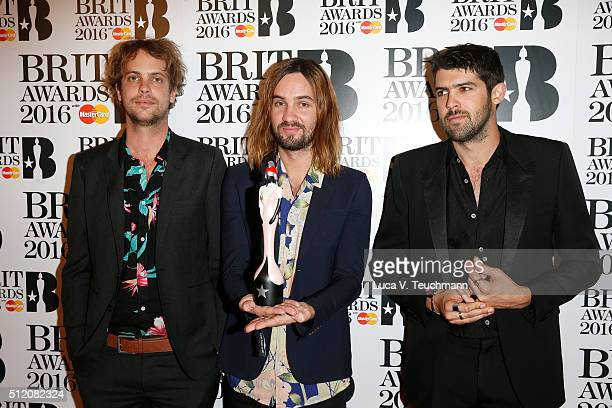 Jay Watson Kevin Palmer and Cam Avery from Tame Impala with their Best International Group award during the BRIT Awards 2016 at The O2 Arena on...