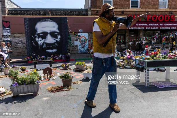 Jay Webb a gardener for George Floyd Square speaks to community at George Floyd Memorial Square on May 25, 2021 in Minneapolis, Minnesota. -...