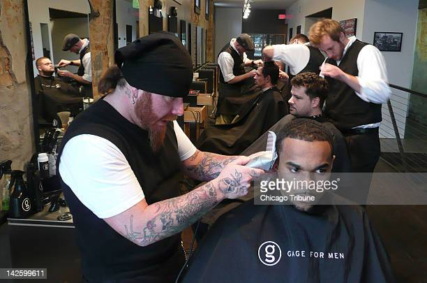 Jay White gives a trim to a customer at Market Street Barbers in the NuLu neighborhood of Louisville Kentucky