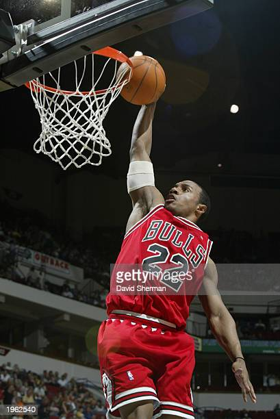 Jay Williams of the Chicago Bulls dunks during the NBA game against the Minnesota Timberwolves at Target Center on April 13 2003 in Minneapolis...
