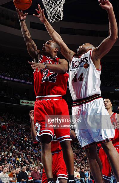 Jay Williams of the Chicago Bulls goes up against Derrick Coleman of the Philadelphia 76ers during the game at First Union Center on February 12 2003...
