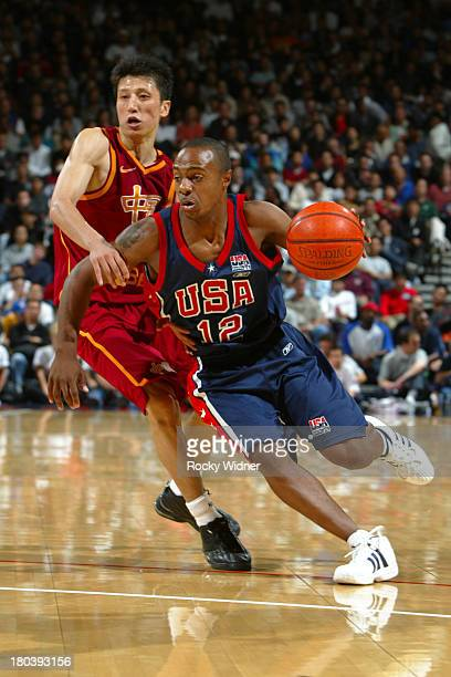 Jay Williams of the USA Basketball Men's Championship Team drives to the basket against the China Men's World Championship Team at The Arena in...