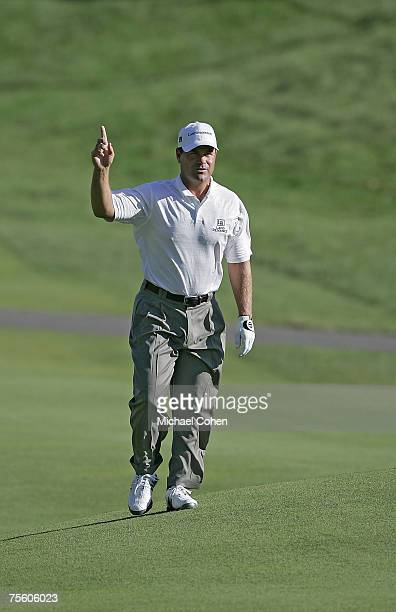 Jay Williamson acknowledges the gallery as he approaches the 18th green during the third round of the Travelers Championship at TPC at River...