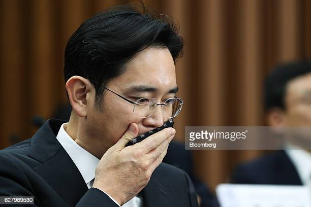 Jay Y Lee covice chairman of Samsung Electronics Co wipes his mouth with a handkerchief during a parliamentary hearing at the National Assembly in...