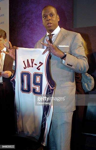 Jay Z also known as Shawn Carter president and chief executive officer of Def Jam Recordings and part owner of the New Jersey Nets holds up a Nets...