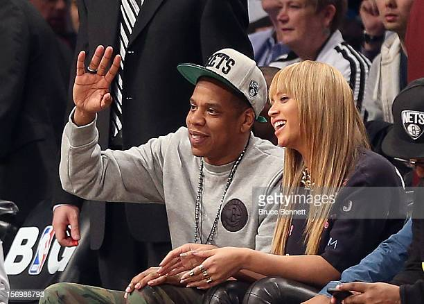 Jay Z and Beyonce attend the game between the Brooklyn Nets and the New York Knicks at the Barclays Center on November 26 2012 in the Brooklyn...