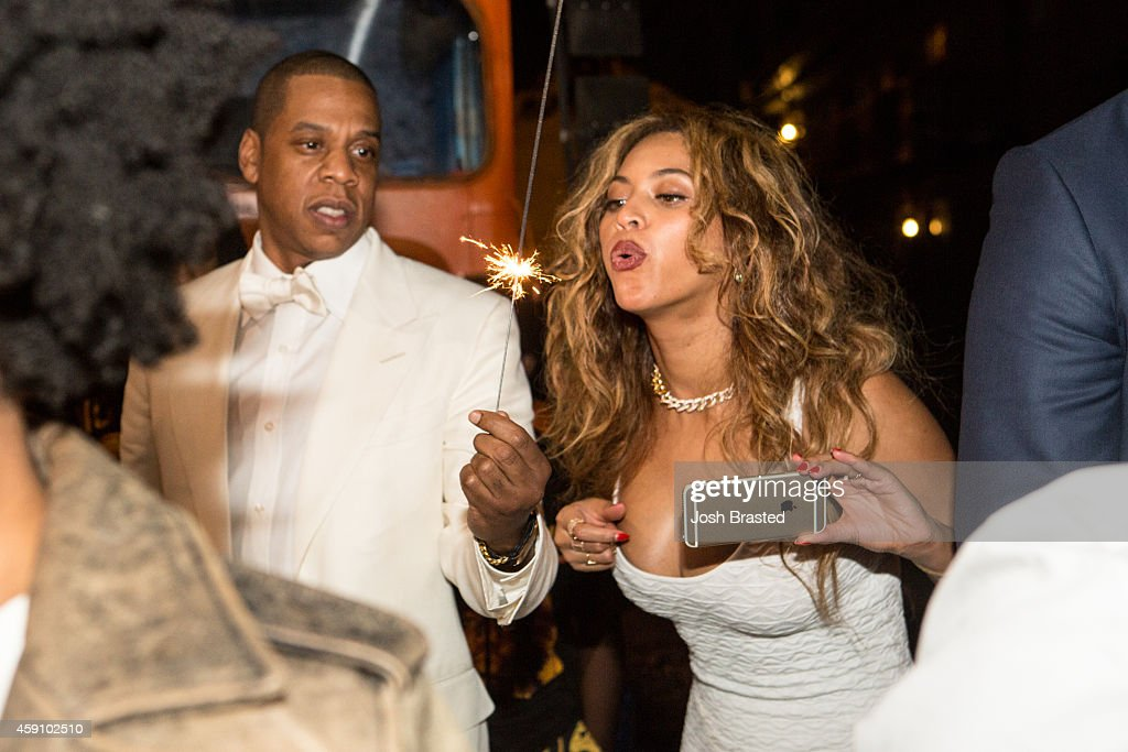 Jay Z (L) and Beyonce Knowles attend the secondline following sister Solange Knowles and her new husband, music video director Alan Ferguson's wedding on the streets of New Orleans on November 16, 2014 in New Orleans, Louisiana.