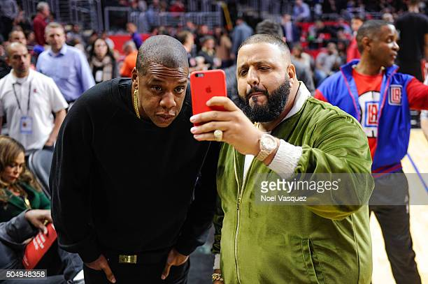Jay Z and DJ Khaled attend a basketball game between the Miami Heat and the Los Angeles Clippers at Staples Center on January 13 2016 in Los Angeles...