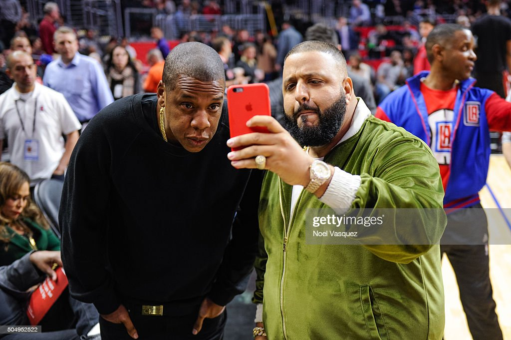 Jay Z (L) and DJ Khaled attend a basketball game between the Miami Heat and the Los Angeles Clippers at Staples Center on January 13, 2016 in Los Angeles, California.