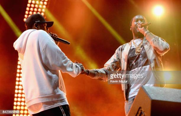 Jay Z and Meek Mill perform during a surprise encore on the Liberty Stage at the 2017 Budweiser Made in America festival Day 2 at Benjamin Franklin...