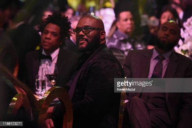 Jay Z Tyler Perry and Juan OG Perez attend the Shawn Carter Foundation Gala at Hard Rock Live in the Seminole Hard Rock Hotel Casino on November 16...