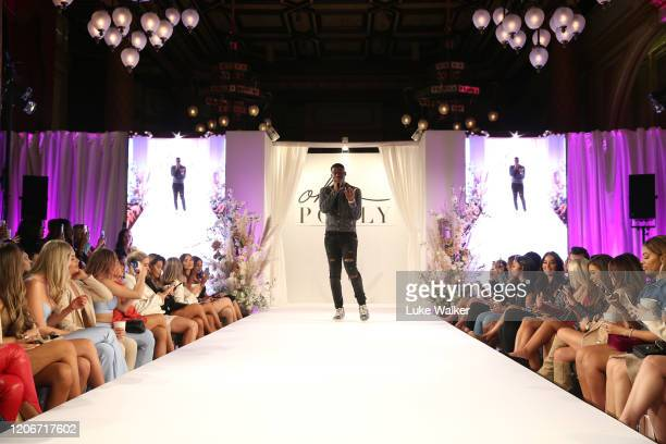Jay1 at the Oh Polly Fashion Show By Planet Fashion at London Fashion Week at The Royal Horseguards on February 16 2020 in London England