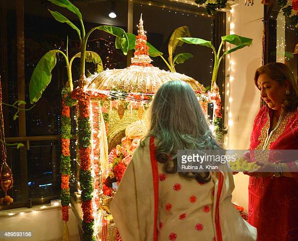 Jaya Bachchan and Rima Jain at the Ganpati Aarti on the sixth day of the ongoing Ganesh Chaturthi festival on September 22 2015 in Mumbai India