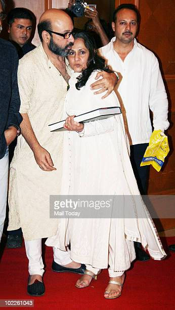 Jaya Bachchan hugs a friend at the launch of 'Chehere' a coffee table book compiled by celebrity photographer Gautam Rajadhakshya in Mumbai on June...