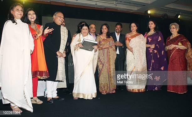Jaya Bachchan Kajol Gautam Rajadakshya Lata Mangeshkar Hema Malini and Padmini Kohlapure on at the launch of Chehere a coffee table book compiled by...