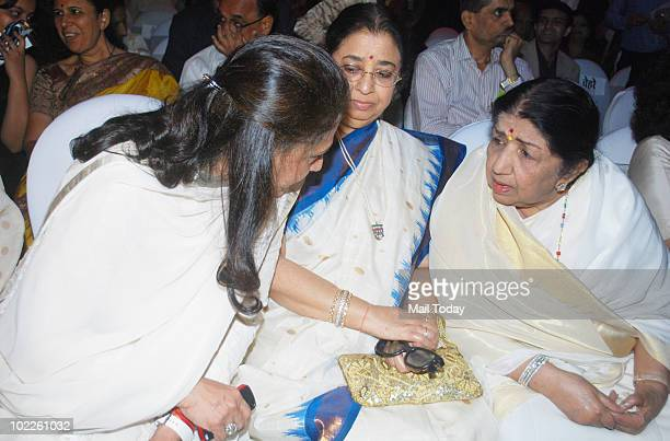 Jaya Bachchan speaks with Lata Mangeshkar as Usha Mangeshkar looks on at the launch of Chehere a coffee table book compiled by celebrity photographer...