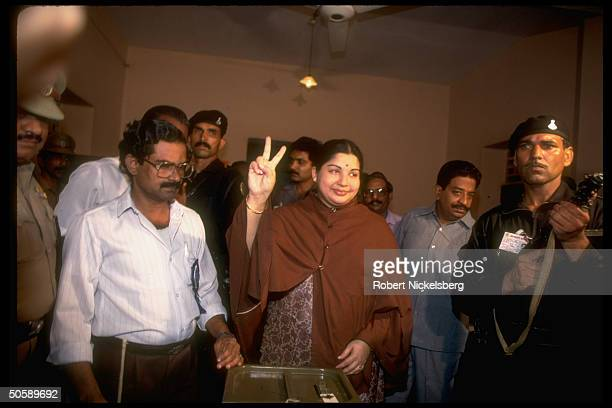 Jayalalitha Aiadmk flashing vsign parliamentary cand Congress I party ally at ballot box voting in elections