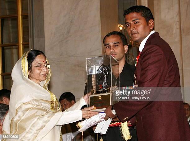 Jayanta Talukdar Archery Player Receiving the Arjuna award from Pratibha Devisingh Patil President of India in New Delhi India