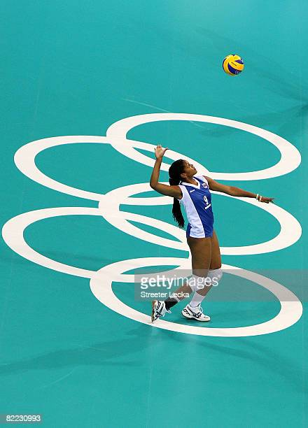 Jayce Andrade of Venezuela serves the ball to China during their women's preliminary volleyball match held at the Capital Indoor Stadium during Day 1...