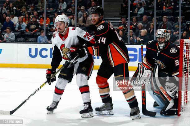 Jayce Hawryluk of the Ottawa Senators battles for position against Michael Del Zotto of the Anaheim Ducks as Ryan Miller holds the crease during the...