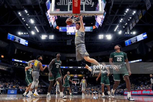 Jayce Johnson of the Marquette Golden Eagles dunks the ball in the second half against the Jacksonville Dolphins at the Fiserv Forum on December 04,...