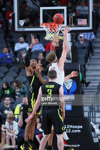 Jayce Johnson of the Utah Utes shoot the ball over Kenny Wooten of the Oregon Ducks during a quarterfinal game of the Pac12 basketball tournament at...