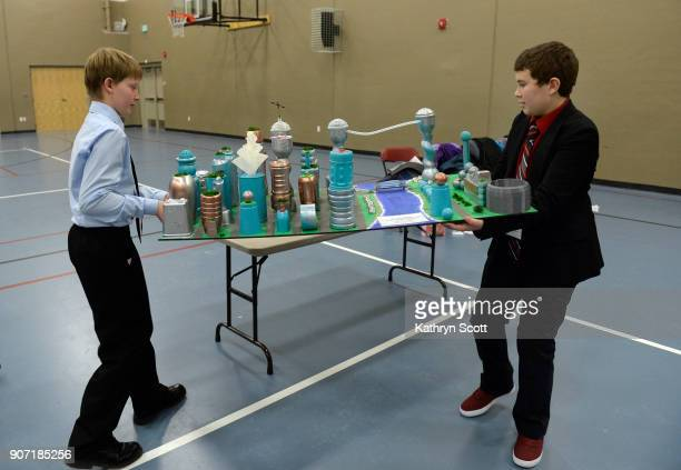 Jayce Whittington right and Bryn Walter bring in their model city 'City of the Waves' to present to the judges and visitors during the Future City...