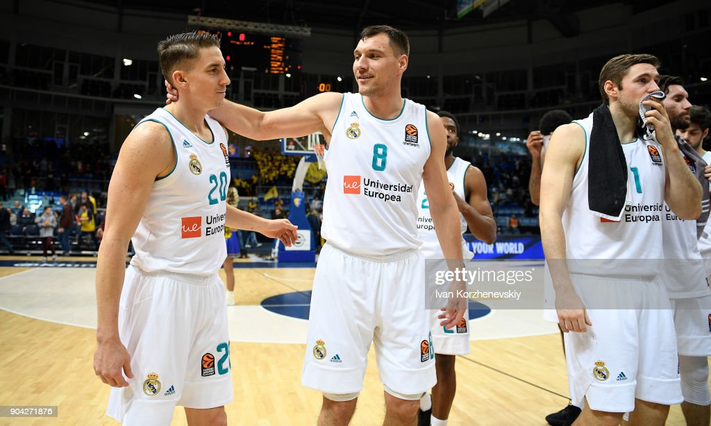 Jaycee Carroll, #20 of Real Madrid and Jonas Maciulis, #8 of Real Madrid celebrate victory during the 2017/2018 Turkish Airlines EuroLeague Regular Season Round 17 game between Khimki Moscow Region and Real Madrid at Arena Mytishchi on January 12, 2018 in Moscow, Russia.