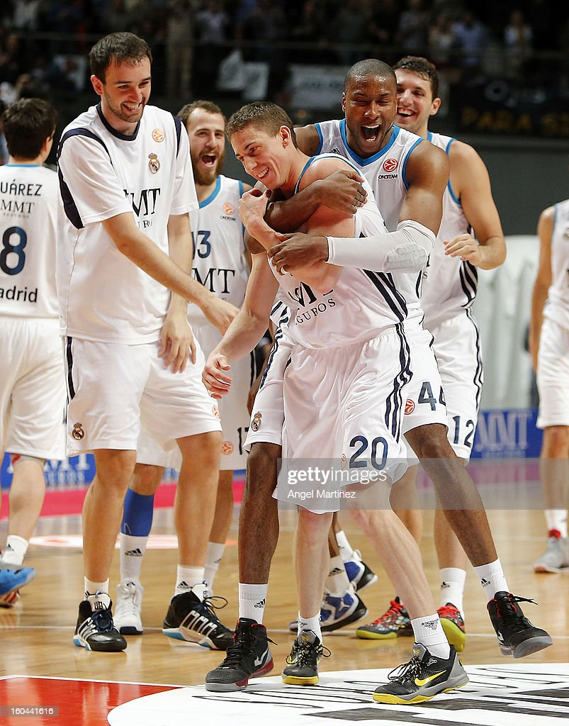 Jaycee Carroll #20 and Marcus Slaughter #44 of Real Madrid celebrate their victory against CSKA Moscow after the Turkish Airlines Euroleague Top 16 game at Palacio de los Deportes on January 31, 2013 in Madrid, Spain.