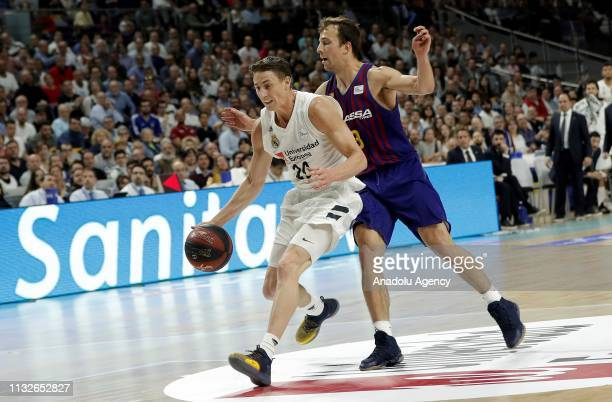 Jaycee Carroll of Real Madrid in action against Kevin Pangos of Barcelona Lassa during the Liga Endesa week 24 match between Real Madrid and FC...