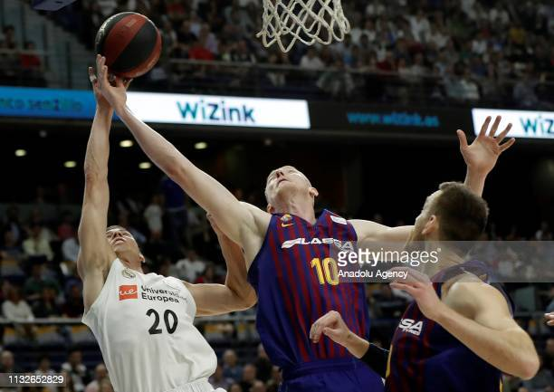 Jaycee Carroll of Real Madrid in action against Rolands Smits of Barcelona Lassa during the Liga Endesa week 24 match between Real Madrid and FC...
