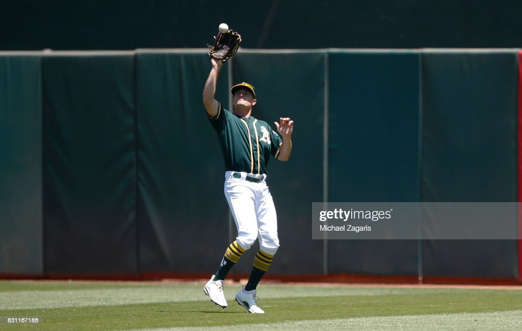 Jaycob Brugman #38 of the Oakland Athletics fields during the game against the Tampa Bay Rays at the Oakland Alameda Coliseum on July 19, 2017 in Oakland, California. The Athletes defeated the Rays 7-2.