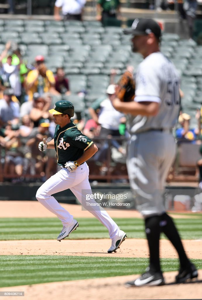 Jaycob Brugman #38 of the Oakland Athletics trots around the bases after hitting a solo home run off of Mike Pelfrey #50 of the Chicago White Sox in the bottom of the fourth inning at Oakland Alameda Coliseum on July 5, 2017 in Oakland, California.