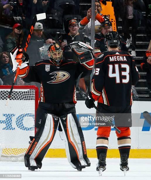 Jaycob Megna of the Anaheim Ducks congratulates Ryan Miller as he becomes the league's winningest USborn goalie following a 52 win over the...