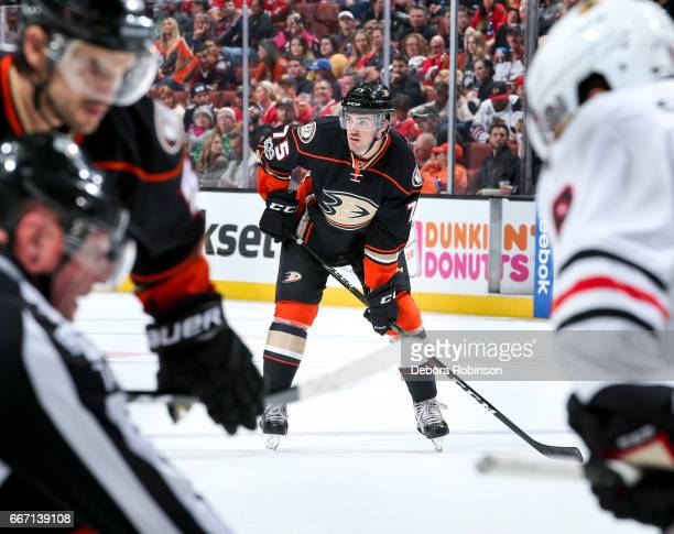 Jaycob Megna of the Anaheim Ducks waits for play to resume during his NHL career debut in the third period of the game against the Chicago Blackhawks...