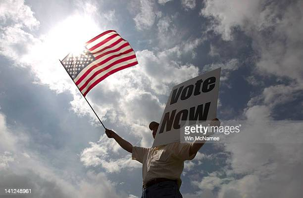 JayDanny Cooper urges Alabama residents to vote in the primary along the side of a highway March 13, 2012 in Birmingham, Alabama. As the race for...
