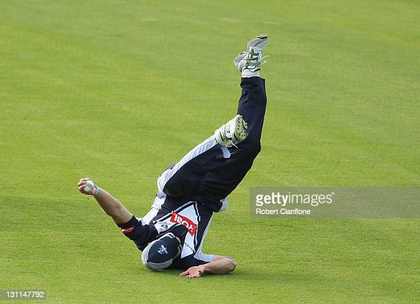 Jayde Herrick of the Bushrangers takes a catch to dismiss Nick Kruger of the Tigers during the Ryobi One Day Cup match between the Tasmania Tigers...