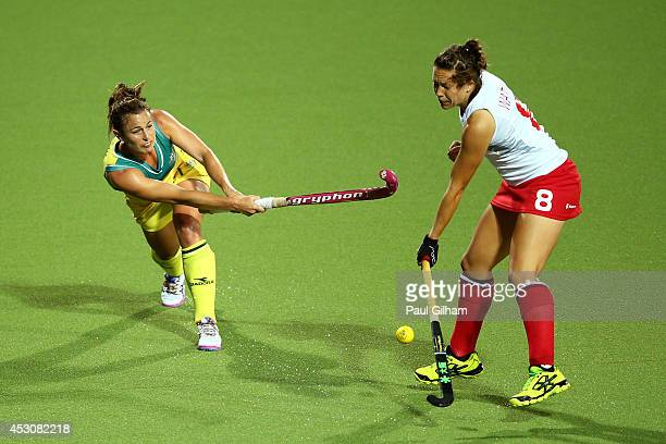 Jayde Taylor of Australia passes as she is closed down by Ellie Watton of England in the Women's Gold Medal Match at Glasgow National Hockey Centre...