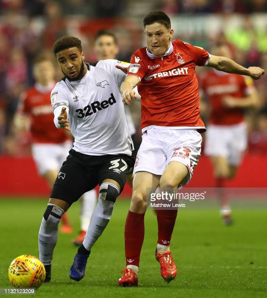 Jayden Bogle of Derby County and Joe Lolley of Nottingham Forest challenge for the ball during the Sky Bet Championship match between Nottingham...