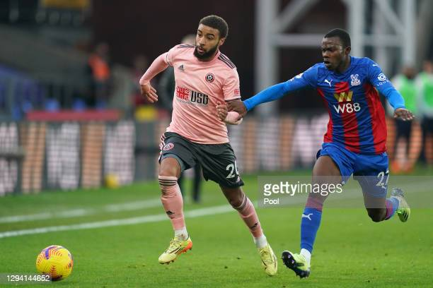 Jayden Bogle of Sheffield United battles for possession with Tyrick Mitchell of Crystal Palace during the Premier League match between Crystal Palace...