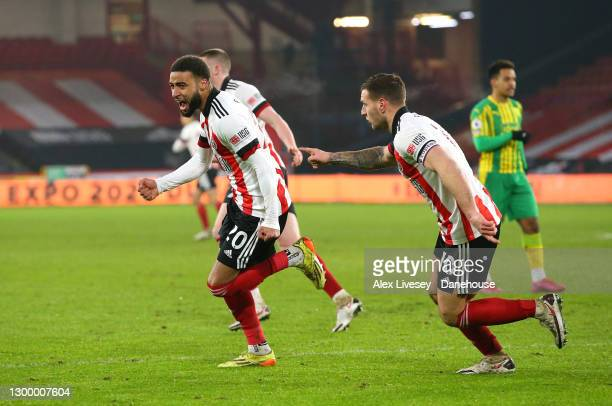 Jayden Bogle of Sheffield United celebrates after scoring their first goal during the Premier League match between Sheffield United and West Bromwich...