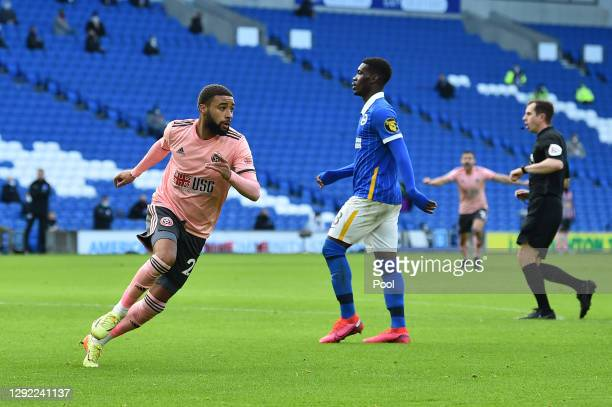 Jayden Bogle of Sheffield United celebrates after scoring their team's first goal during the Premier League match between Brighton & Hove Albion and...