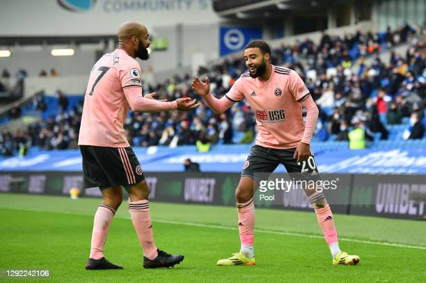Jayden Bogle of Sheffield United celebrates with David McGoldrick after scoring their sides first goal during the Premier League match between...