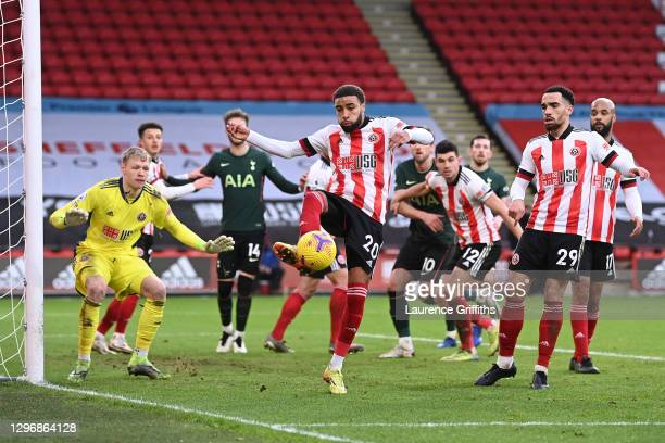 Jayden Bogle of Sheffield United clears the ball from a corner as team mates Aaron Ramsdale and Kean Bryan watch on during the Premier League match...