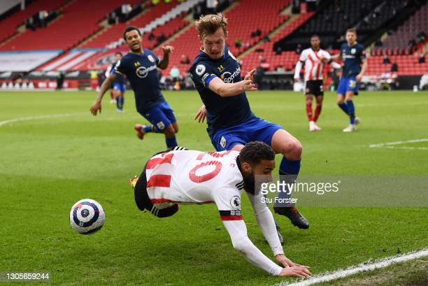 Jayden Bogle of Sheffield United goes do ground after a challenge from James Ward-Prowse of Southampton during the Premier League match between...