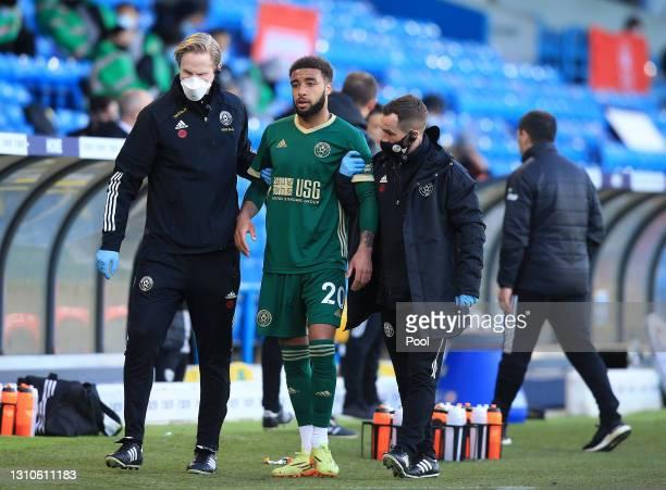 Jayden Bogle of Sheffield United goes off injured during the Premier League match between Leeds United and Sheffield United at Elland Road on April...